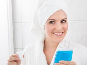 happy-woman-holding-bottle-mouthwash